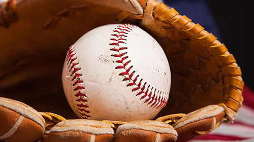 53449886 - a baseball and glove with an american flag background.